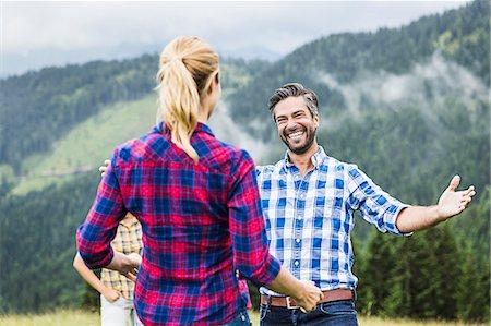 Man greeting woman with open arms, Tirol, Austria Stock Photo - Premium Royalty-Free, Code: 649-07437337