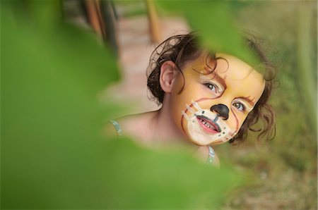Girl with face painting of animal Stock Photo - Premium Royalty-Free, Code: 649-07437355