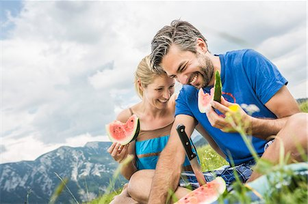 partnership - Couple eating watermelon at picnic Stock Photo - Premium Royalty-Free, Code: 649-07437367