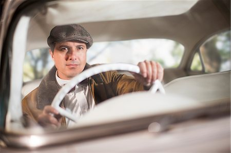 Close up of man in vintage car Stock Photo - Premium Royalty-Free, Code: 649-07437385