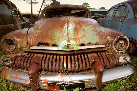 Close up of vintage car in scrap yard Stock Photo - Premium Royalty-Free, Code: 649-07437390
