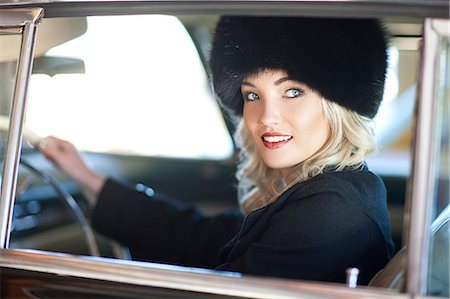 Woman with fur hat driving vintage car Stock Photo - Premium Royalty-Free, Code: 649-07437417
