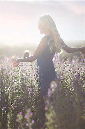 Girl dancing on meadow Stock Photo - Premium Royalty-Free, Code: 649-07437431