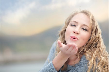 Woman blowing a kiss, Hout Bay, Cape Town, South Africa Stock Photo - Premium Royalty-Free, Code: 649-07437472