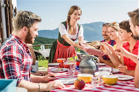 Group of friends at breakfast outside chalet, Tyrol, Austria Stock Photo - Premium Royalty-Free, Code: 649-07437524