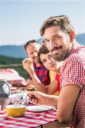 Friends enjoying breakfast outside, Tyrol, Austria Stock Photo - Premium Royalty-Free, Code: 649-07437522