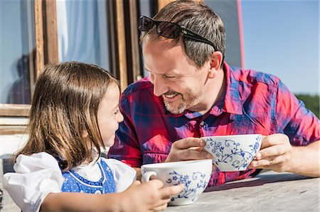 dress up girl - Close up portrait of father and daughter outside chalet, Tyrol, Austria Stock Photo - Premium Royalty-Free, Code: 649-07437535