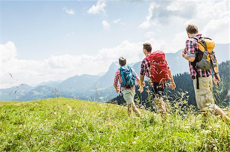 Male friends hiking, Tyrol, Austria Stock Photo - Premium Royalty-Free, Code: 649-07437548