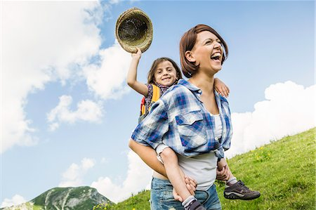 Mother and daughter on hike, girl holding straw hat Stock Photo - Premium Royalty-Free, Code: 649-07437554