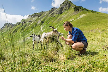 Mid adult woman with goats, Tyrol, Austria Stock Photo - Premium Royalty-Free, Code: 649-07437553