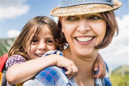 portrait looking away - Portrait of mother and daughter smiling Stock Photo - Premium Royalty-Free, Code: 649-07437587