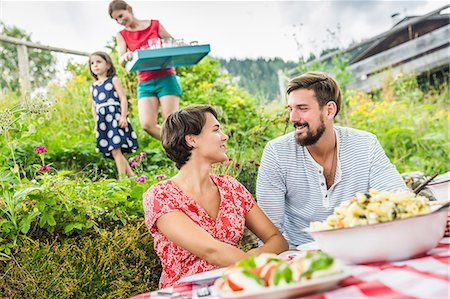 Young couple sharing picnic lunch, Tyrol, Austria Stock Photo - Premium Royalty-Free, Code: 649-07437625