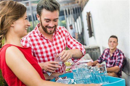 Young man flirting with waitress, Tyrol, Austria Stock Photo - Premium Royalty-Free, Code: 649-07437627