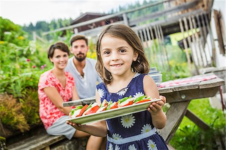 Young family preparing picnic lunch, Tyrol, Austria Stock Photo - Premium Royalty-Free, Code: 649-07437622