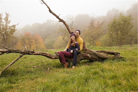 dead woman - Young couple sitting on bare tree in misty park Stock Photo - Premium Royalty-Free, Code: 649-07437639