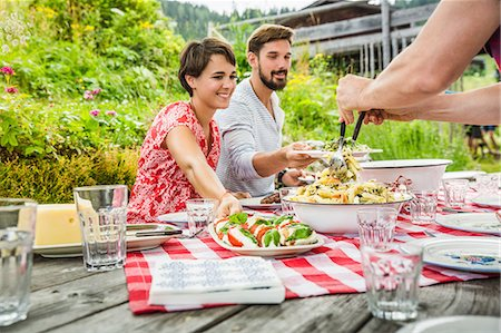 Group of friends sharing picnic lunch, Tyrol, Austria Stock Photo - Premium Royalty-Free, Code: 649-07437630