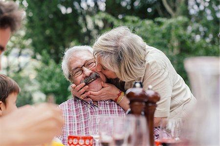 Senior woman kissing husband on cheek Stock Photo - Premium Royalty-Free, Code: 649-07437663