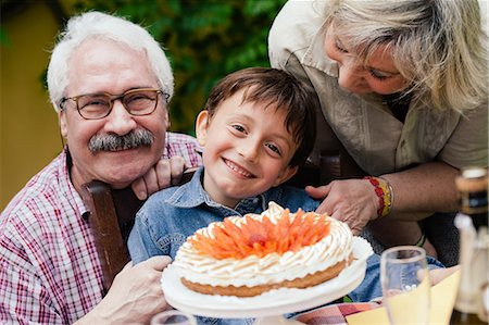 Boy with birthday cake from grandparents Stock Photo - Premium Royalty-Free, Code: 649-07437672