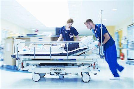 people hospital - Two medics pushing gurney in hospital emergency room Stock Photo - Premium Royalty-Free, Code: 649-07437681