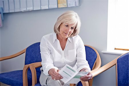 results - Mature female patient reading leaflet in hospital waiting room Stock Photo - Premium Royalty-Free, Code: 649-07437696