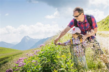european - Father and daughter looking at plants, Tyrol, Austria Stock Photo - Premium Royalty-Free, Code: 649-07437711