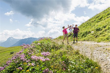 Parents and daughter having fun on walk, Tyrol, Austria Stock Photo - Premium Royalty-Free, Code: 649-07437713