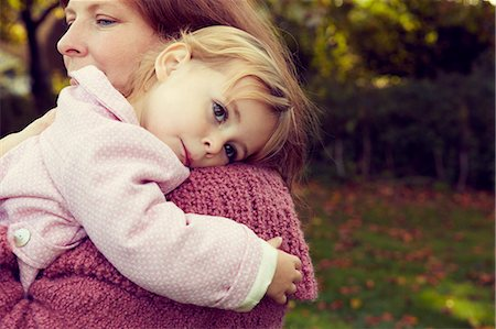 Mother hugging daughter Stock Photo - Premium Royalty-Free, Code: 649-07437727