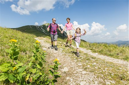 Parents and daughter walking on dirt track, Tyrol, Austria Stock Photo - Premium Royalty-Free, Code: 649-07437720