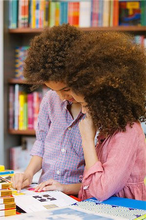 preteen long hair - Brother and sister browsing design book in library Stock Photo - Premium Royalty-Free, Code: 649-07437765