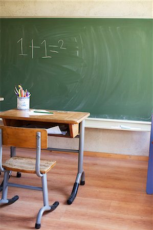 Desk and blackboard with sum Stock Photo - Premium Royalty-Free, Code: 649-07437854