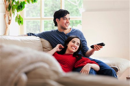 day - Young couple watching TV on living room sofa Stock Photo - Premium Royalty-Free, Code: 649-07437889