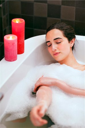 Young woman relaxing in bubble bath Stock Photo - Premium Royalty-Free, Code: 649-07437893