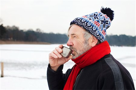 Man outdoors having hot drink Stock Photo - Premium Royalty-Free, Code: 649-07438000