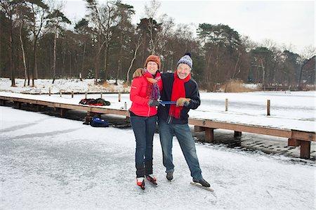Couple ice skating, holding hands Stock Photo - Premium Royalty-Free, Code: 649-07438001
