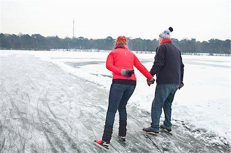 Couple ice skating, holding hands Stock Photo - Premium Royalty-Free, Code: 649-07438002