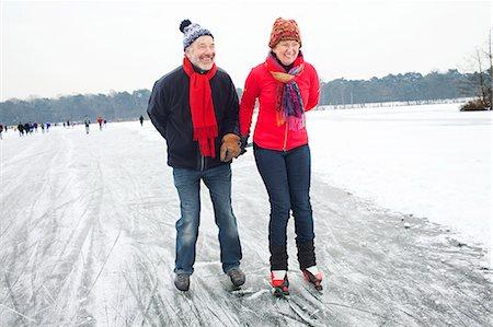 Couple ice skating, holding hands Stock Photo - Premium Royalty-Free, Code: 649-07438003