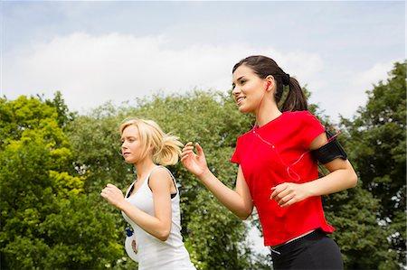 Women jogging through park Stock Photo - Premium Royalty-Free, Code: 649-07438058