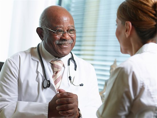 Senior doctor with female patient Stock Photo - Premium Royalty-Free, Image code: 649-07438113