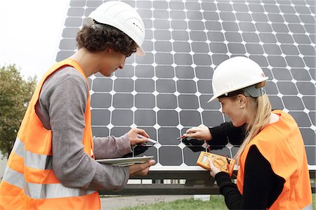 solar power - Man and woman working on photo voltaic panels Stock Photo - Premium Royalty-Free, Code: 649-07438157