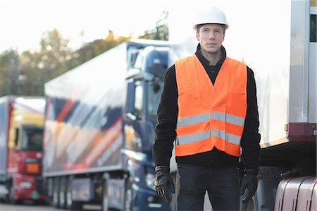 safety - Builder standing in front of truck Stock Photo - Premium Royalty-Free, Code: 649-07438162