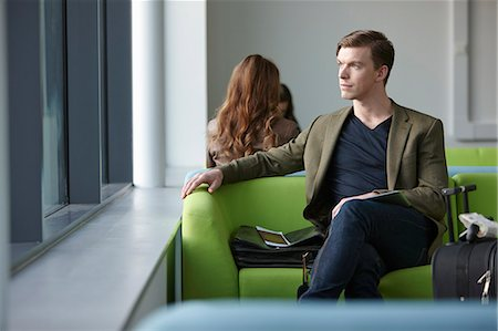 Young man in departure lounge Stock Photo - Premium Royalty-Free, Code: 649-07520040