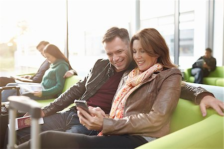 five people - Mature couple in departure lounge Stock Photo - Premium Royalty-Free, Code: 649-07520041