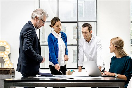 four - Business people in meeting at office Stock Photo - Premium Royalty-Free, Code: 649-07520117