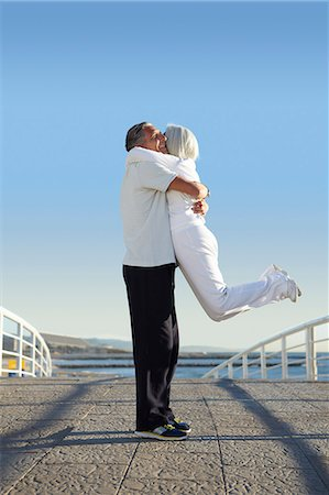 fitness   mature woman - Man lifting woman up Stock Photo - Premium Royalty-Free, Code: 649-07520144
