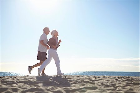 Couple jogging on beach Stock Photo - Premium Royalty-Free, Code: 649-07520147