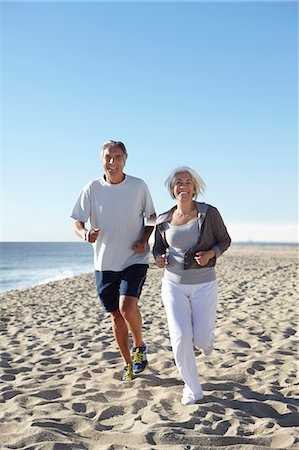 fitness   mature woman - Couple jogging on beach Stock Photo - Premium Royalty-Free, Code: 649-07520148