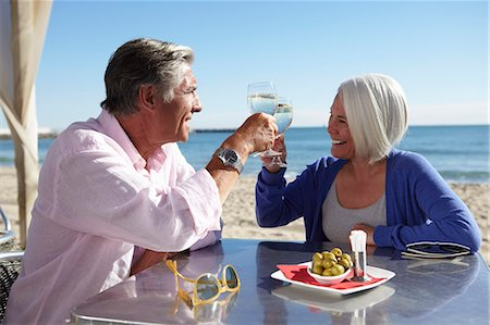 Couple enjoying wine by seaside Stock Photo - Premium Royalty-Free, Code: 649-07520157