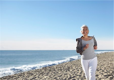 fitness   mature woman - Mature woman jogging on beach Stock Photo - Premium Royalty-Free, Code: 649-07520150