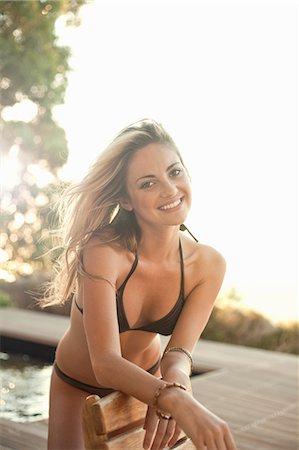 Woman in bikini posing by pool Stock Photo - Premium Royalty-Free, Code: 649-07520194