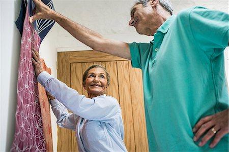 Senior couple making decision on wallpaper Stock Photo - Premium Royalty-Free, Code: 649-07520214